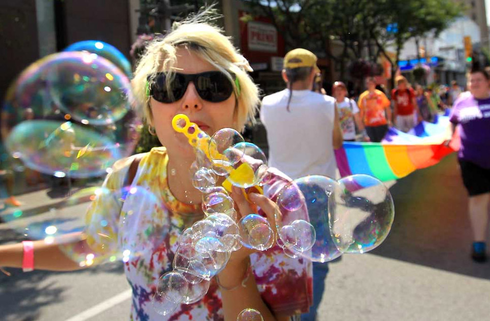 Woman in Pride Fest Parade with bubbles
